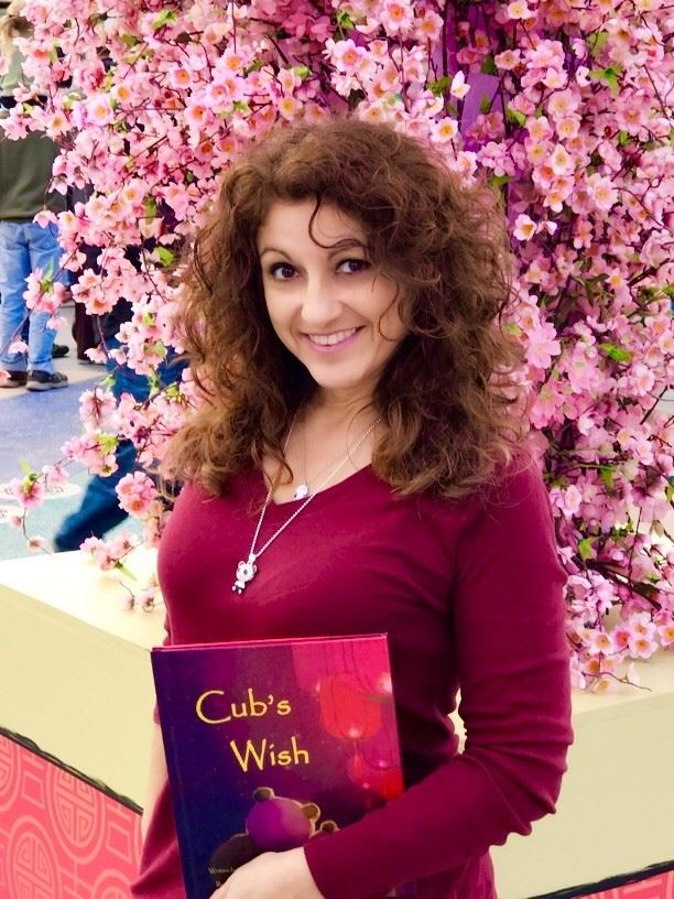 Author Angie Flores at Universal Studios Hollywood with her book Cub's Wish